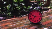 clock : Clock running slow with rain drop slash in slow motion Stock Footage