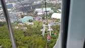 Hong Kong Cable car ride from forest park to ocean Stock Footage