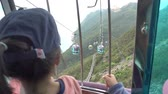 Children is riding on a Cable Car crossing mountain Vídeos