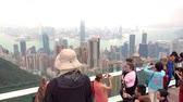 Hong Kong, Hong Kong - Oct 12, 2018: People are taking picture of Hong Kong Skyline on the Observation deck.