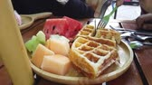 People using fork to eat Waffle Pancake with fruits Vídeos