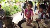 cruche : Bangkok, Thailand - 1 January 2019 : Children is learning to make pottery in Thai Village