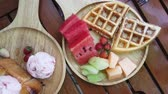 icecream : Ice cream served with waffle and fruit watermelon strawberry cantaloup and toasts
