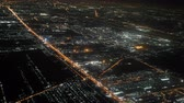 Illuminated city in dark night ,   aerial window seat view airplane. Lights on approach to landing at airport