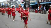 symbol of respect : Phuket, Thailand - 27 August 2018 - Street performance parade in Chinese Hungry Ghost festival (Por Tor) , lady in red chinese traditional costume hand hold red flour turtle symbol of festival