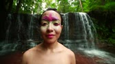beauty female face : Borneo Rainforest Tribal Culture: Face Painting Stock Footage