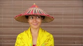 playful : Attractive asian lady with hat