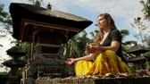 meditation : caucasian woman meditating yoga in balinese temple