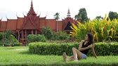 kamboçyalı : Asian attractive girl on grass, national museum, phnom penh, cambodia Stok Video