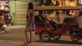 sexo : prostitute waiting for costumer on street at night