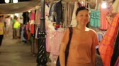 colar : Chinese Young Woman Shopping at asian night market Stock Footage