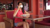 beauty female face : gorgeous asian woman in cafe, drinking coffee, tea