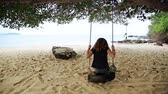 sonhar : tourist girl enjoying at swing at beach, sihanoukville, cambodia Stock Footage