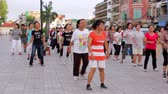 fitness : PHNOM PENH - JUNE 2012: outdoor tai chi in city center