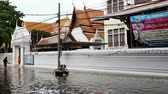 storm : Street under flood in Bangkok Thailand. People use boats Life continues