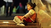 gipsy : poor child begging at the entrance of metro and people passing without helping