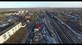 sleepers : View from above of a train locomotive on two railway tracks surrounded by green grass. Train tracks top view in nature Stock Footage