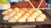 dotonbori : process to cooking takoyaki most popular delicious snack of japan