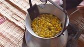 narin : Boiling yellow silkworm cocoons by boiler to make silk thread.