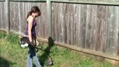 Teen using string trimmer