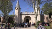 avlu : Tourists entering the gate of Salutation of Topkapi Palace, which was the primary residence of the Ottoman sultans  for approximately 400 years. 30.04.2017, Turkey, Istanbul
