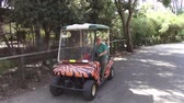 Tourist rides elestrokare at the zoo, 24.09.2015, Israel, Tel Aviv Dostupné videozáznamy