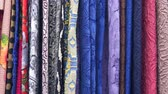 yorgan : Drapery. Hundreds of different fabrics. Selection of various color options, camera movement along fabrics