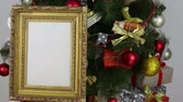 Golden frame on the background of Christmas tree