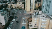 City drone flying over houses, monitoring order in yards, aerial view, israel