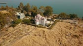 filistin : Orthodox Church of the 12 apostles. Sea of Galilee. Capernaum. Aerial dolly Stok Video