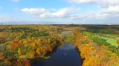 yaprak döken : Aerial: Taking surrounded by fall foliage pond in multirotor  16  October 21, 2015 to the shooting in Japan of a Forest Park  Autumn leaves and pond blue sky and clouds bleeds through. Stok Video