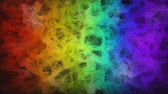 Rainbow color digital smoke flowing over black background. Colorful cloud particles