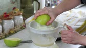 Grapefruit juice. Squeezing the juice of a green grapefruit. Stock Footage