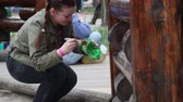 working parents : Melitopol. Ukraine - April 12, 2016: People clean in a city park.