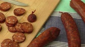 dry sausage : Traditional homemade sausage on the wooden cutting board Stock Footage