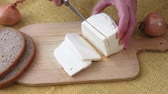 фета : Healthy food. Goat cheese on a wooden cutting board. Стоковые видеозаписи