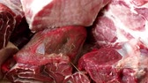kasap : Different types of raw meat and beef. Raw meat on wooden table. Stok Video