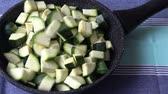 Vegetarian food.Preparation of zucchini in frying pan. Стоковые видеозаписи