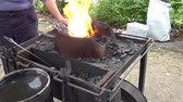 Fire, Live Coals and Blacksmiths Tools. Handmade products.