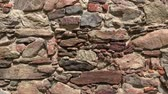 dry wall : Old castle stone wall.Texture of a stone wall Stock Footage