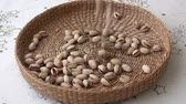 kernels : Many pistachios. There are nuts in the basket