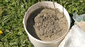 plaster : mixing cement in a bucket