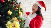 papai noel : Merry Christmas and Happy Holiday woman decorate the Christmas tree indoor