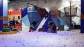 nemluvně : Time lapse Indoor amusement park on mall.children with their parents playing on large soft playground
