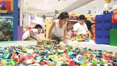 colorful backgrounds : NAKHONRATCHASIMA, THAILAND - MAY 1, 2019:Time lapse Close up childs hands playing with a small lego bricks