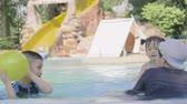 meninos : Asian little boy and girl relex enjoy playing ball in pool Stock Footage