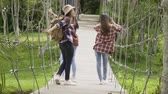 beautiful building : Asian young girls standing on wood bridge looking in nature