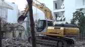 burr : Bulldozer demolishing building close up audio