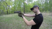 man shoots from airsoft gun outdoor