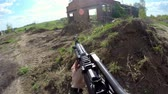 Person shoot from airsoft automatic rifle first view